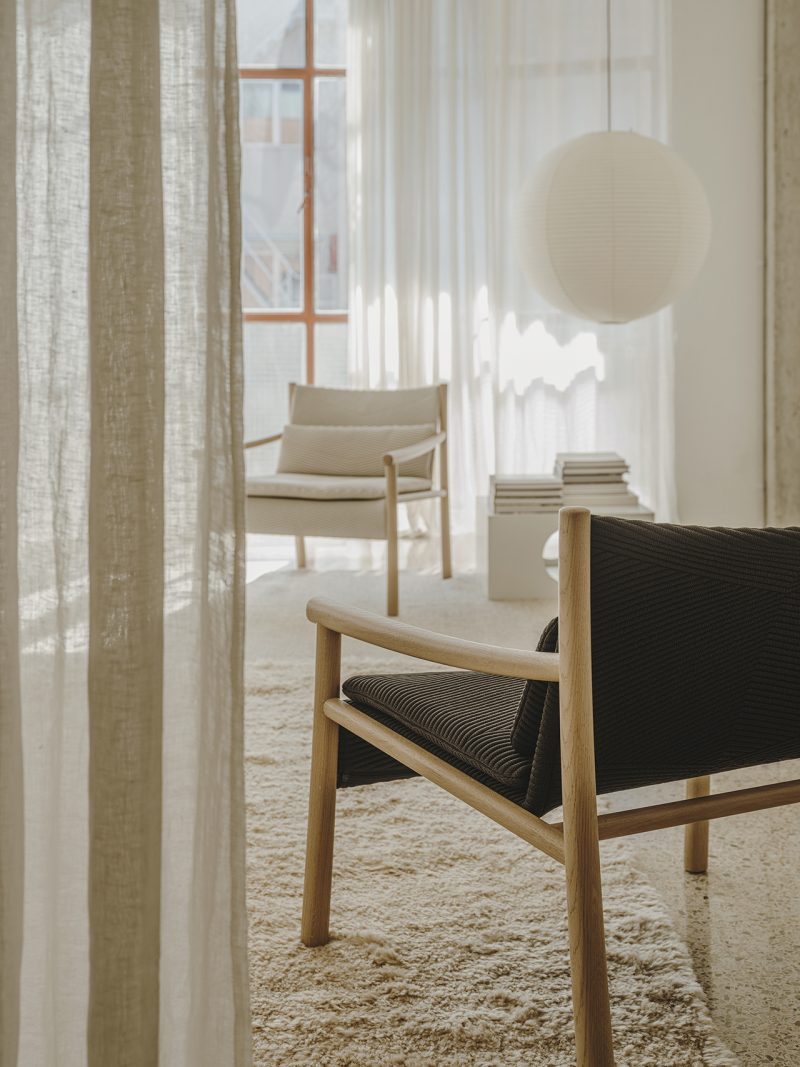 two armchairs in light-filled living space