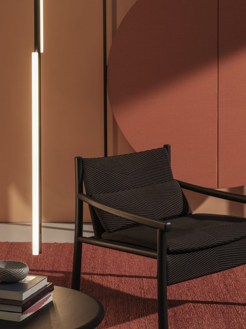 dark armchair in rust colored room
