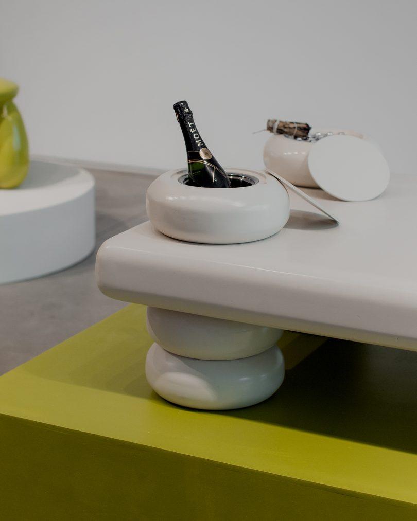 white table on lime green pedestal