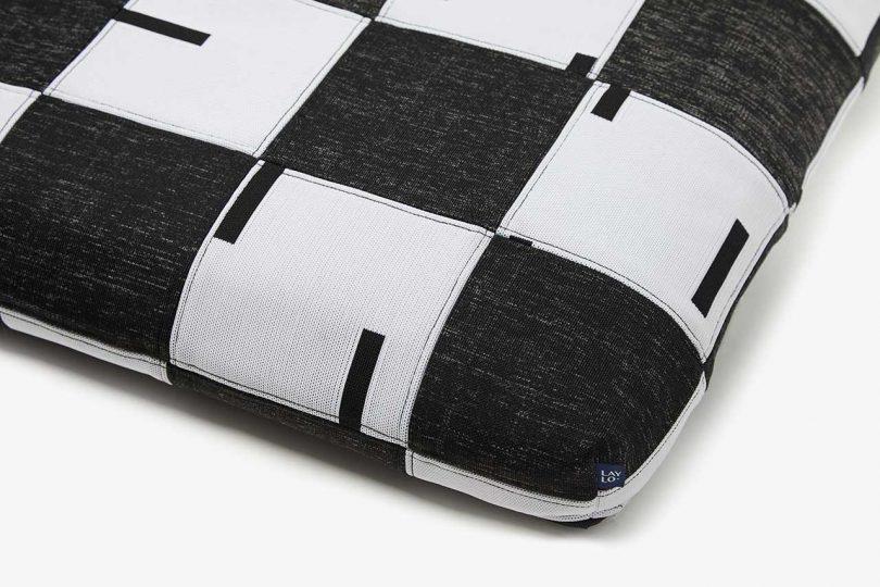 black and white patchwork dog bed corner