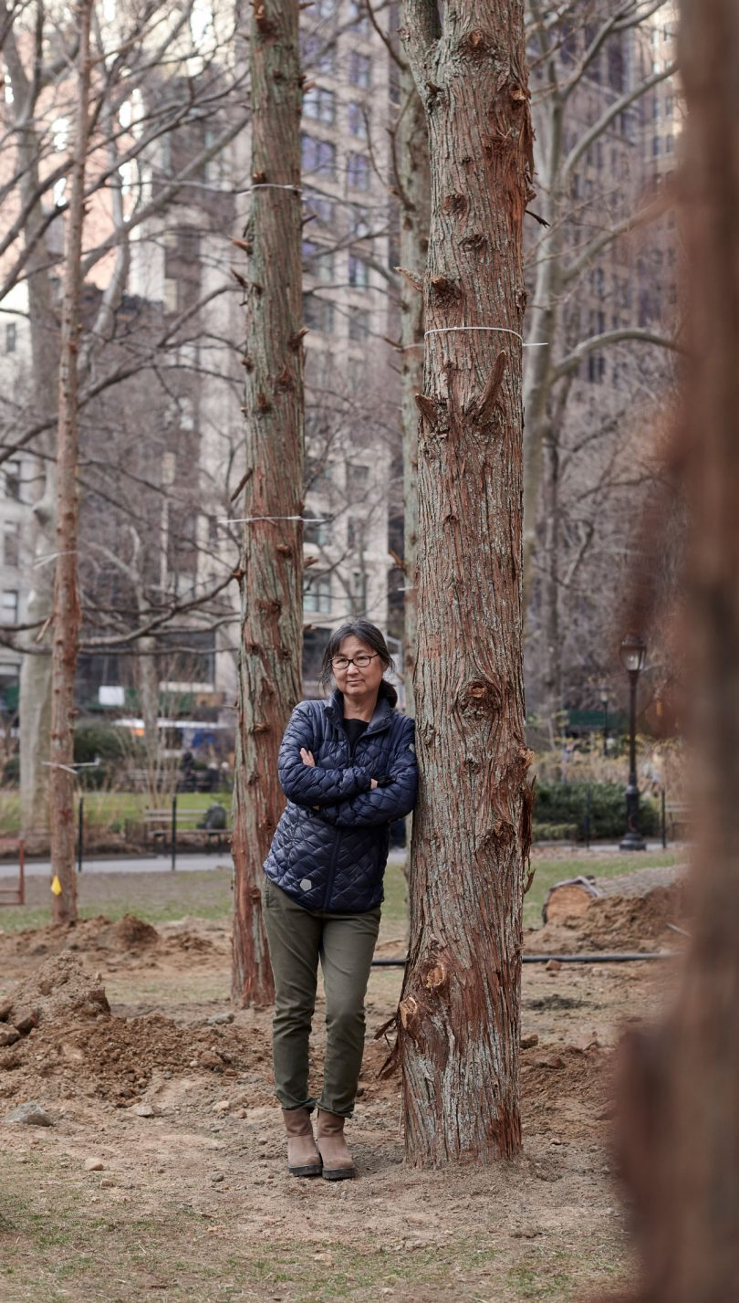 Maya Lin stands within Ghost Forest