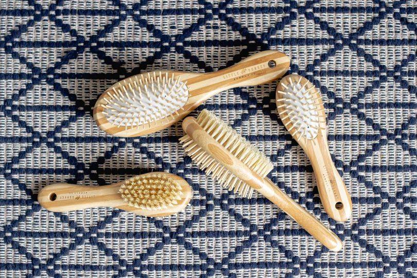 four bamboo dog brushes