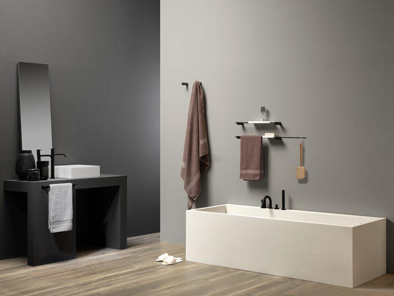 modern bathroom with grey walls and wood floors