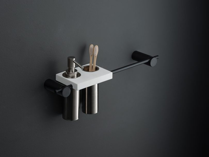 modern sink accessories hanging on black wall