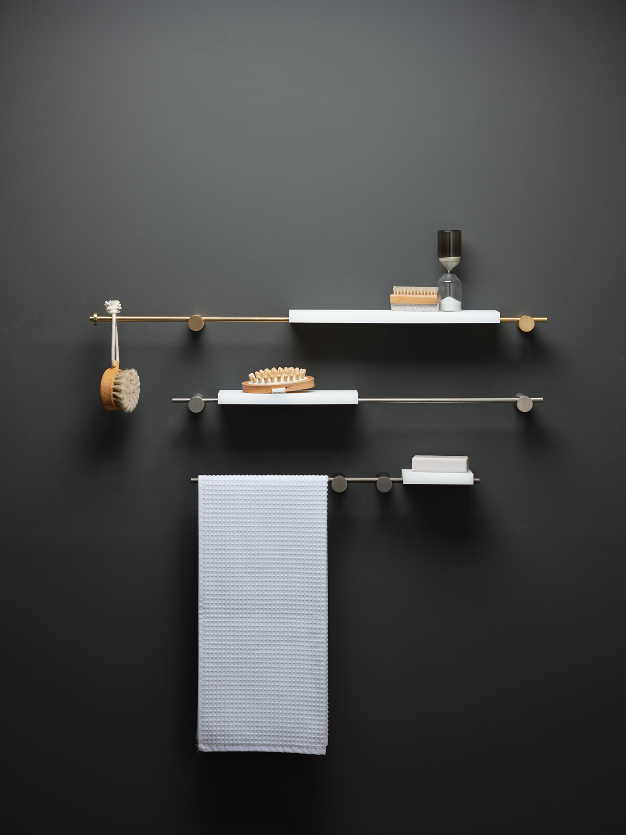 modern bath accessories and shelves hanging on black wall
