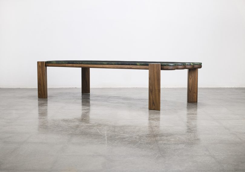 coffee table on cement floor in front of white wall