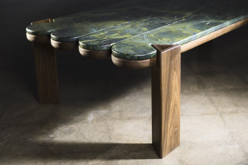 wood and marble coffee table detail sitting on concrete floor