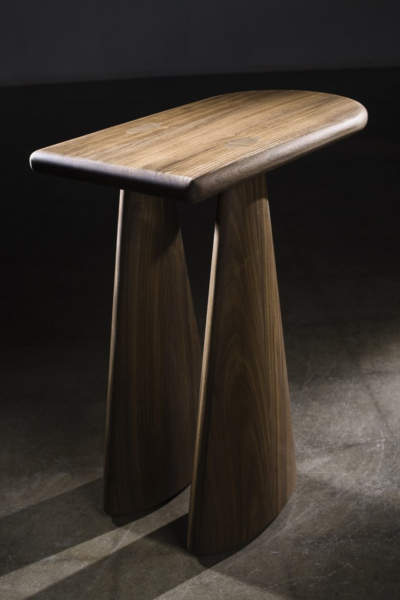 wood side table on cement floor and black background
