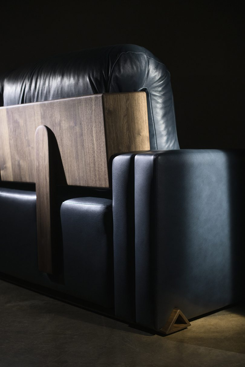 leather and wood sofa detail on dark background