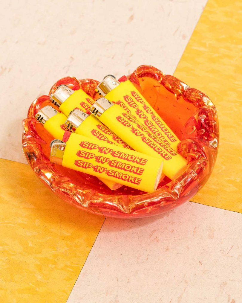 glass dish with yellow and red lighters