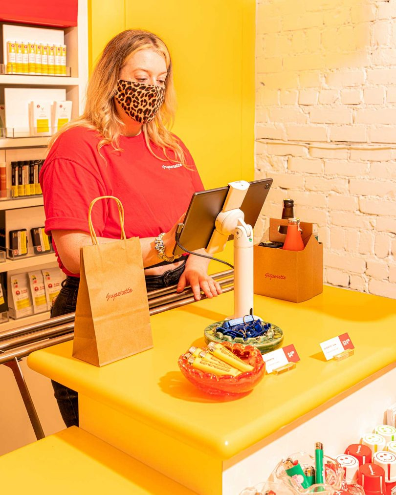 cashier checking customers out at cannabis store