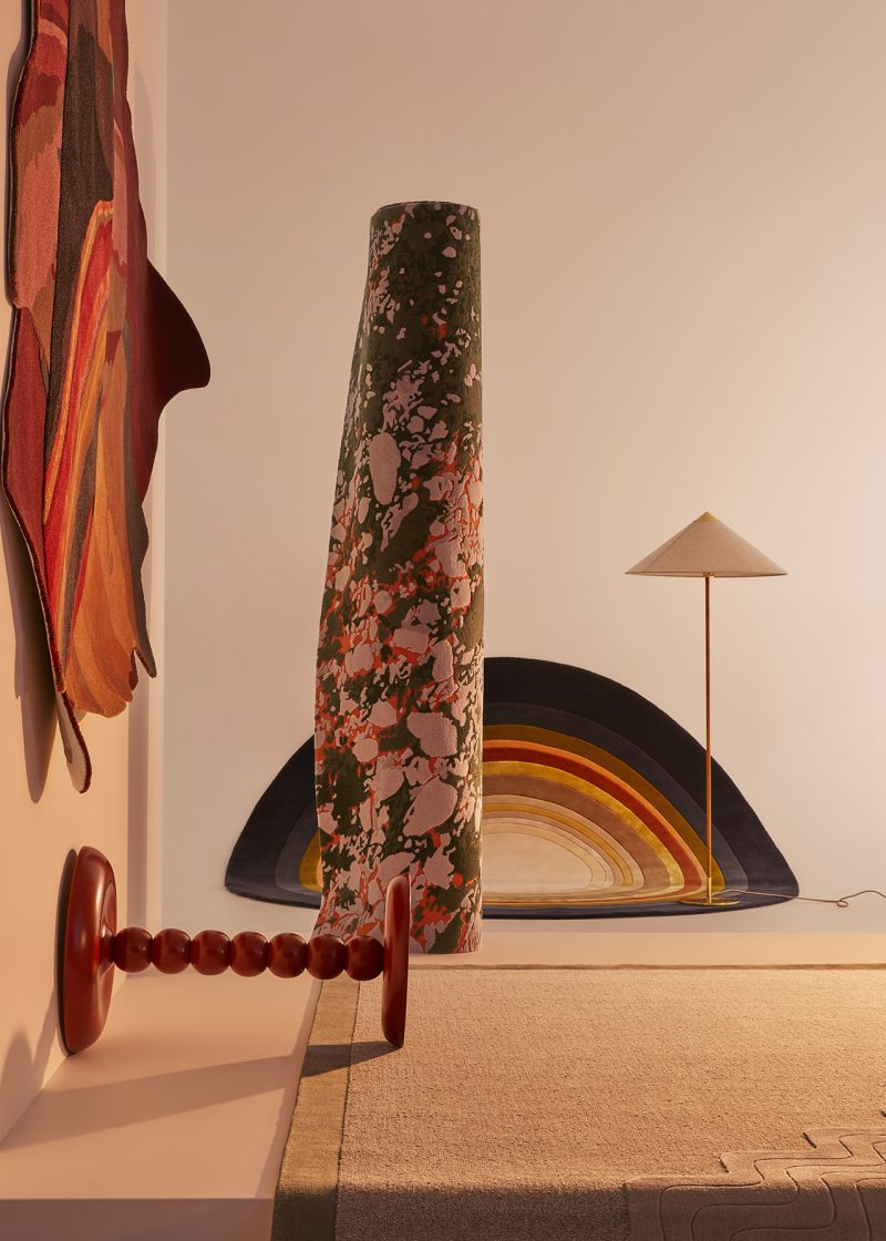 four styled rugs with lamp and table