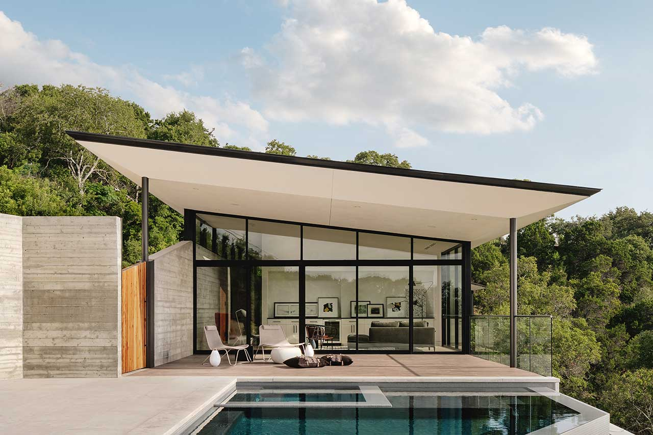 slanted roof house with pool