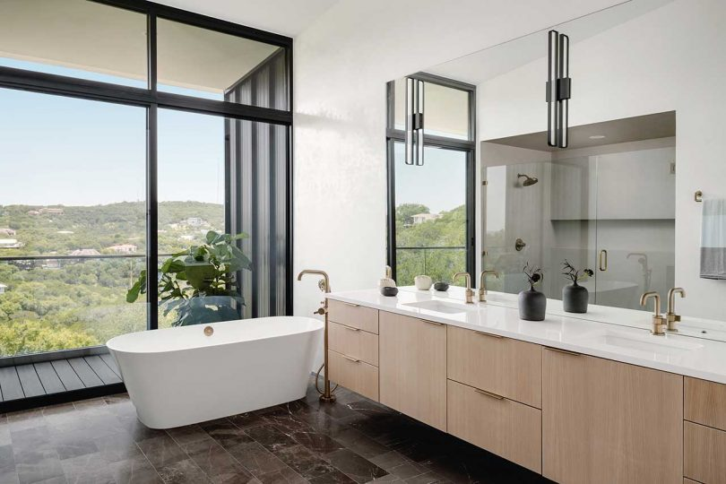 modern bathroom looking out to canyon