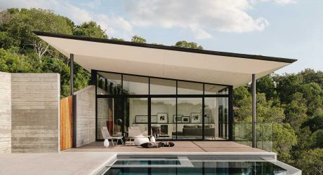 A Boomerang-Shaped House With Canyon and City Views of Austin