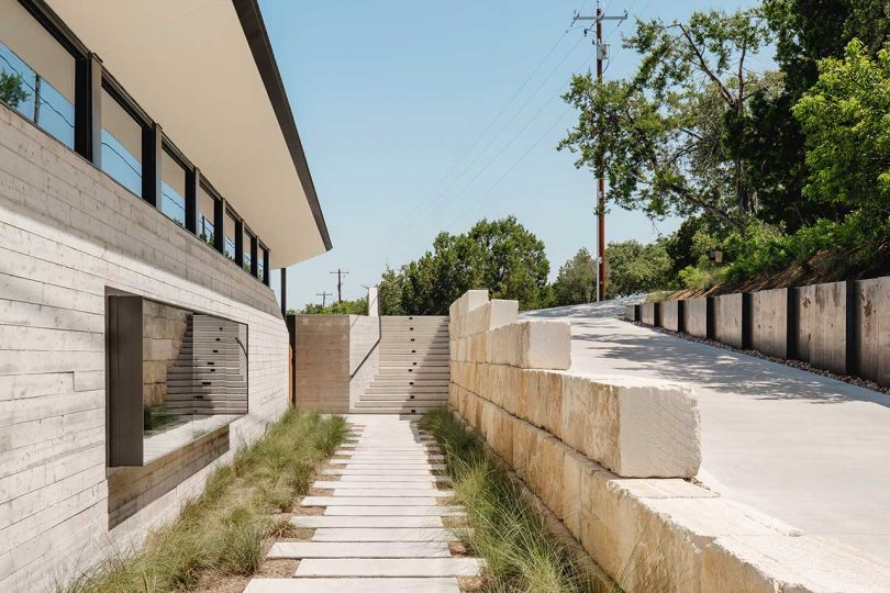 walkway by side of modern house and driveway