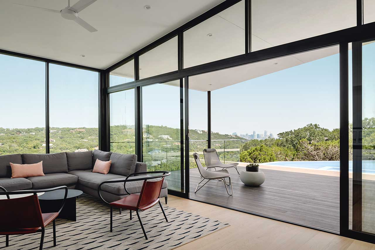 living room looking out through windows to outdoor deck