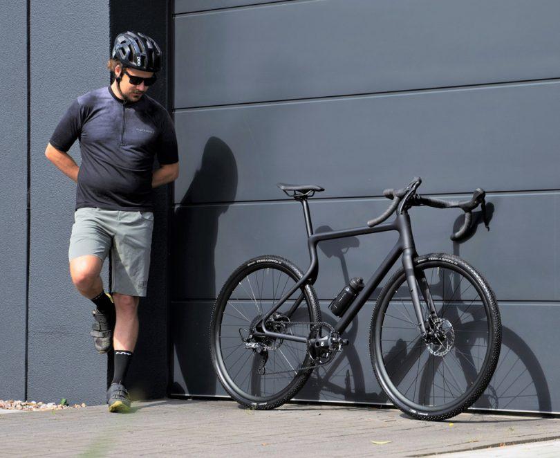 Black bio-bike variant leaning against black wall.
