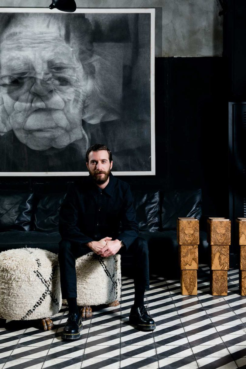 man posing for portrait sitting on stool