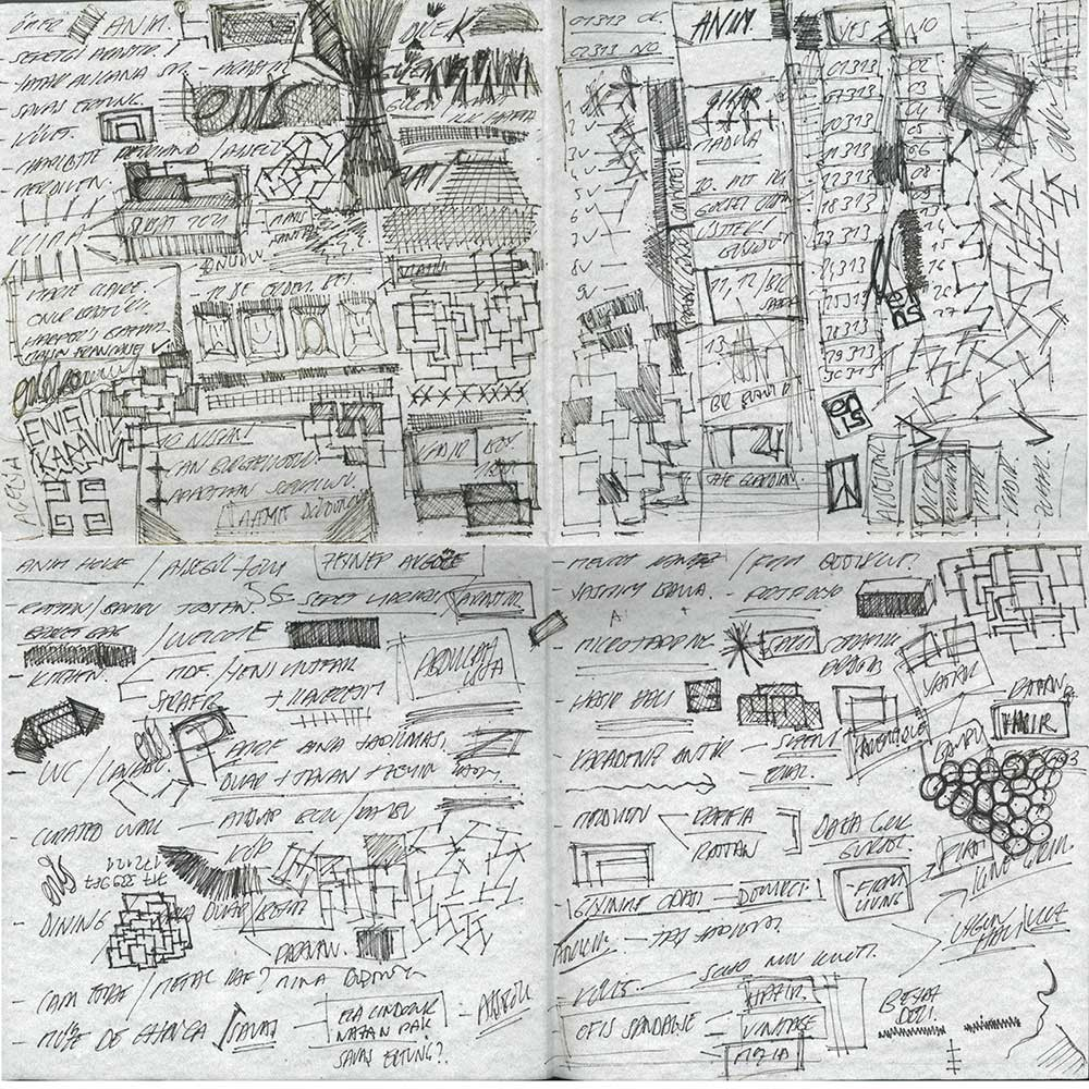 notes and sketches on an unfolded napkin