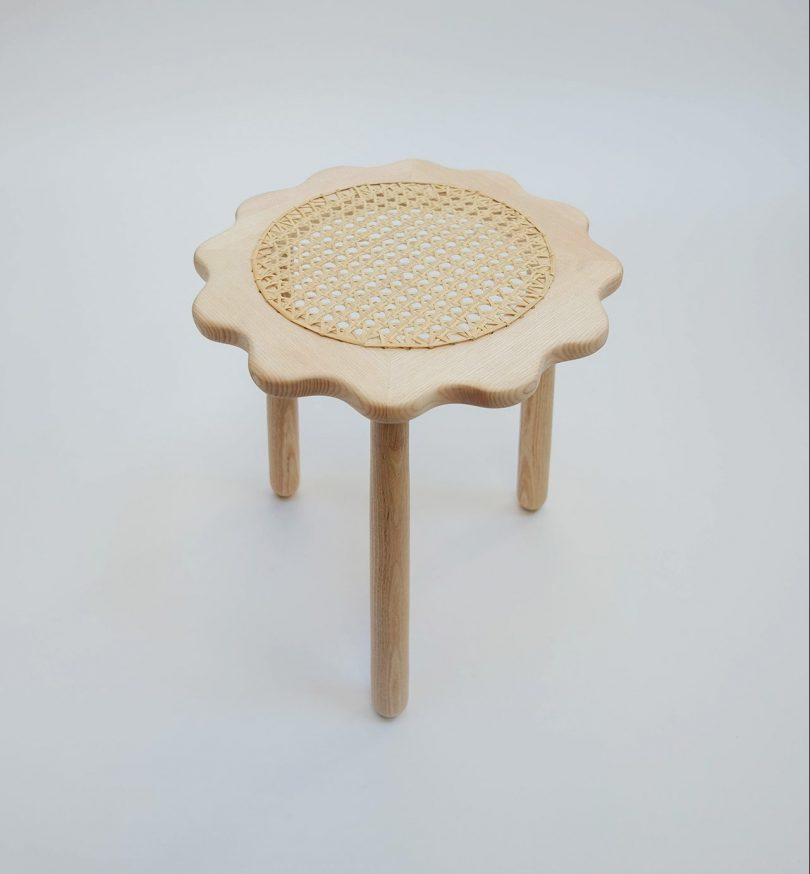 light wood caned stool