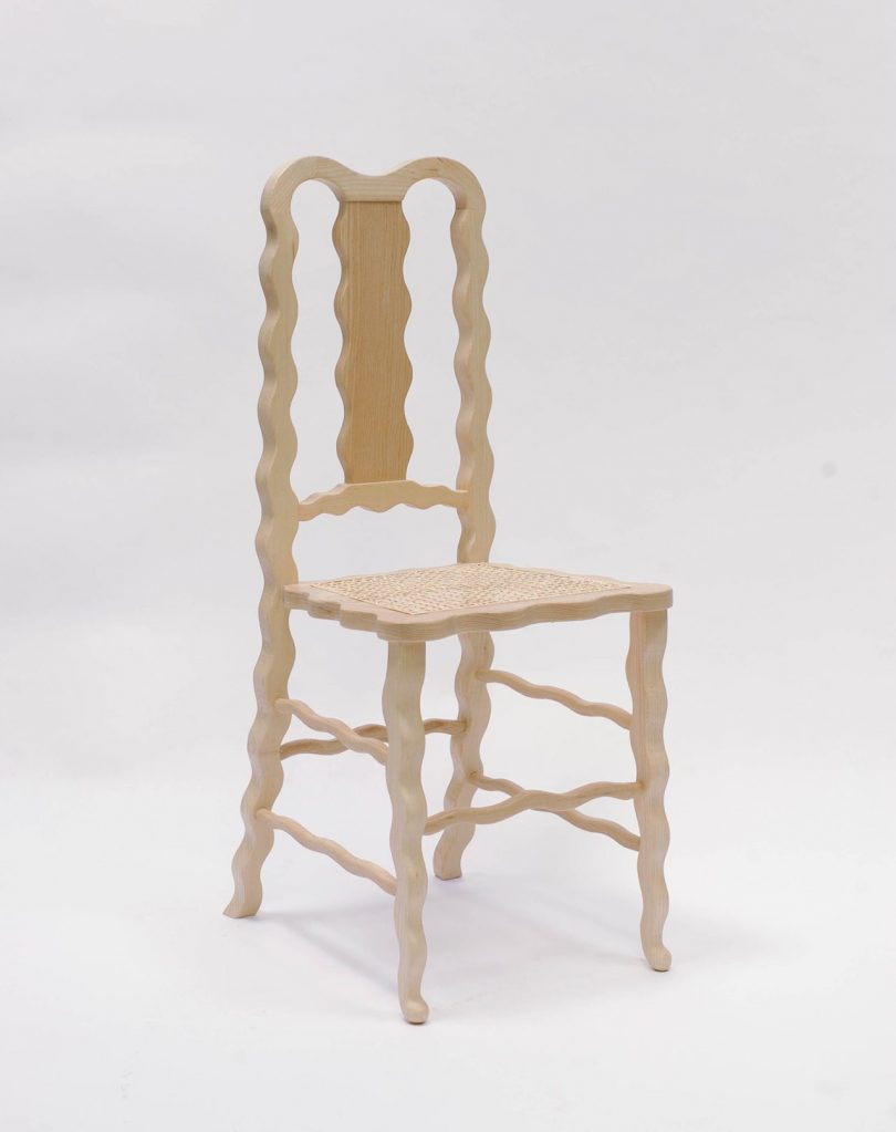 light wood dining chair with squiggly lines