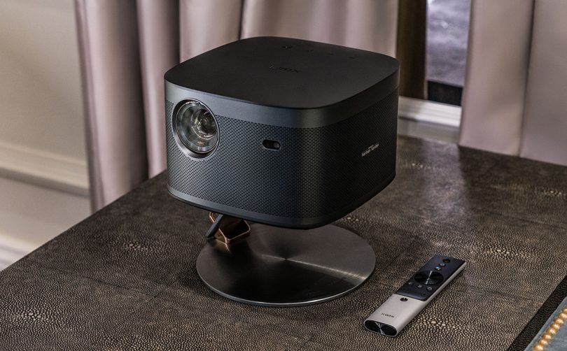 Projector on small stand with remote