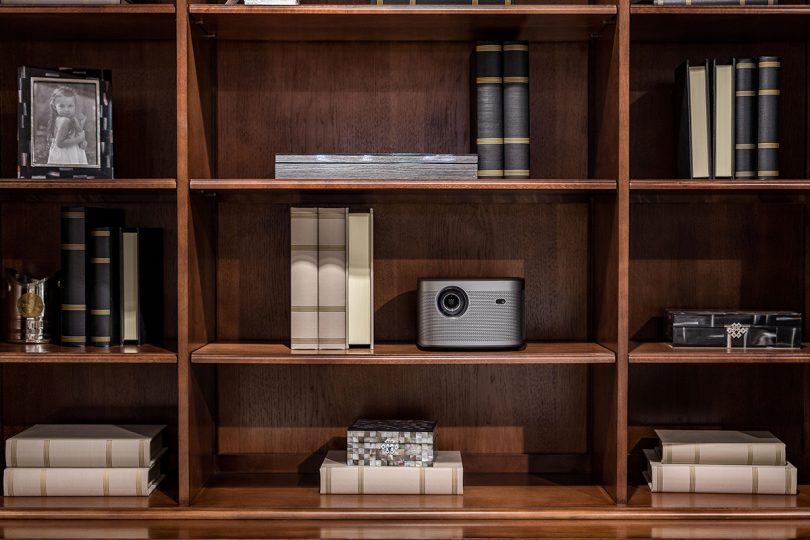 XGIMI Horizon Pro on bookshelf.