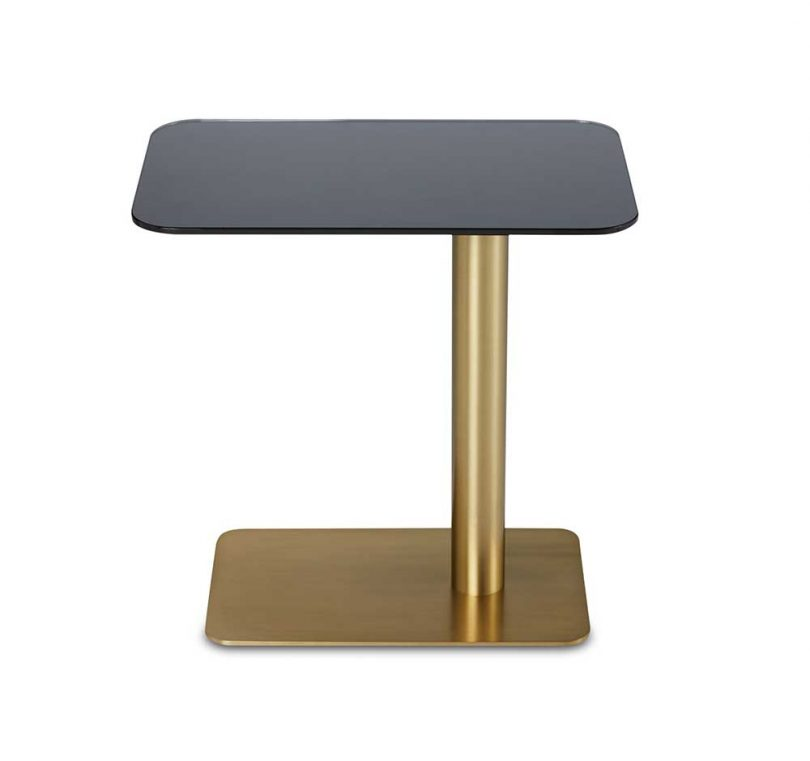 side table with brass base and glossy black glass tabletop