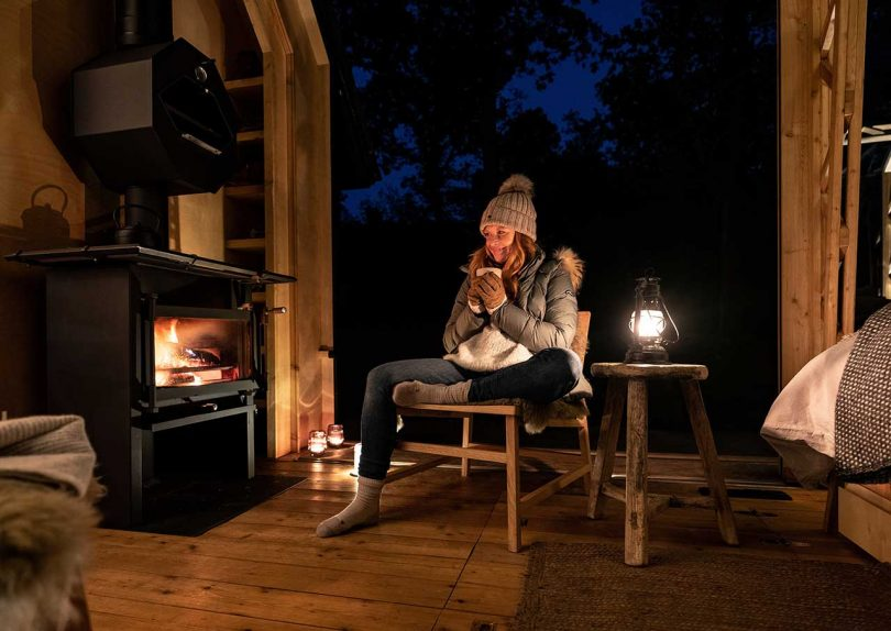 inside cabin at night with girl by fire