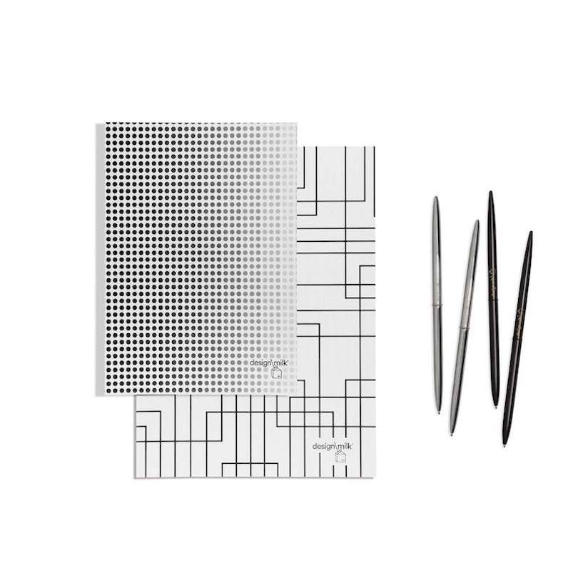 Design Milk black and white notebook, planner, and pens