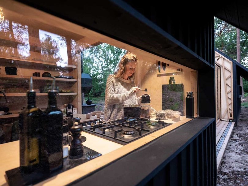 view into cabin of girl making tea