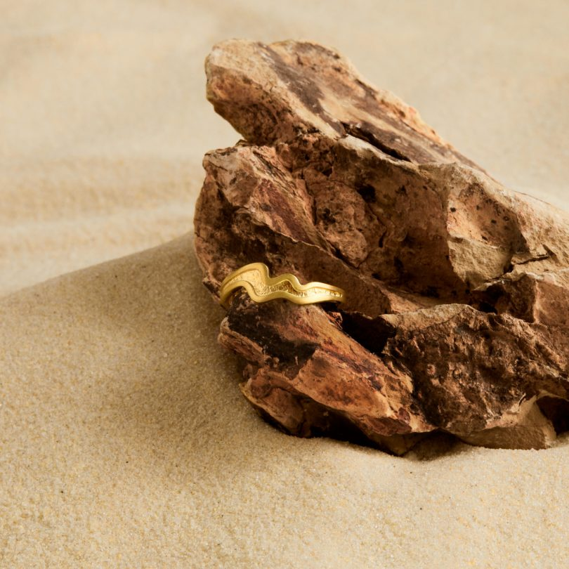 gold plated silver ring on rock
