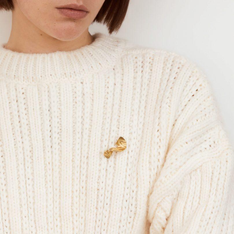 gold brooch on model