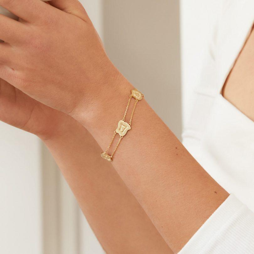 gold bracelet on model
