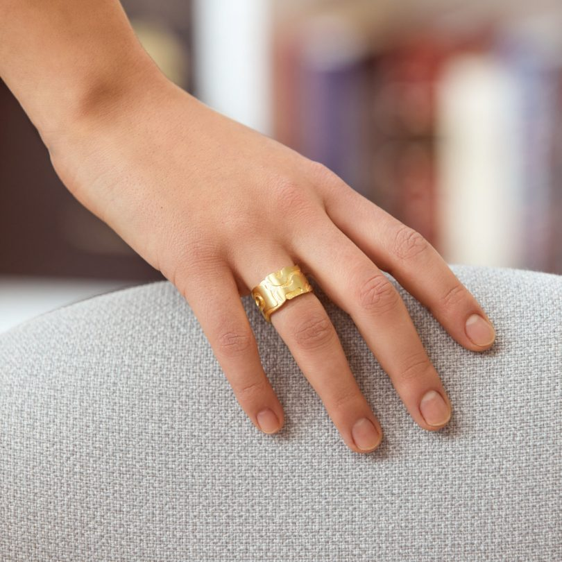 modern gold ring on hand