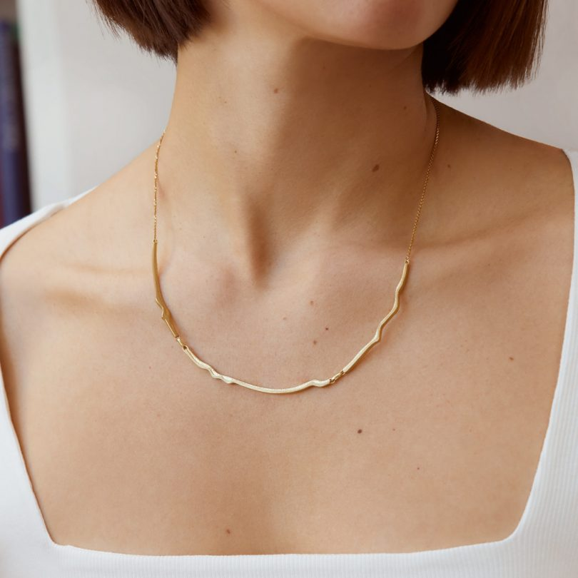 gold plated necklace on model