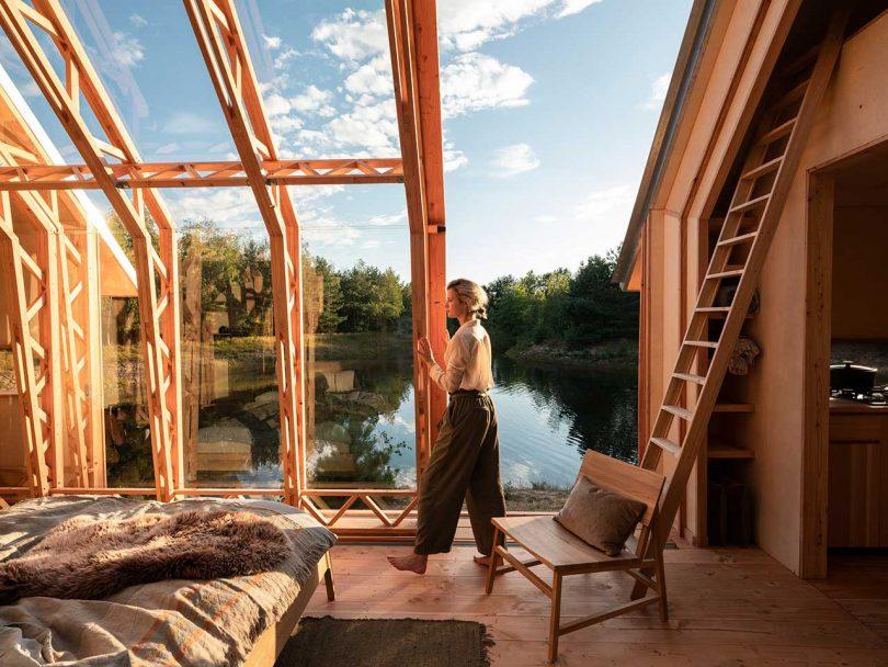 open roof cabin in the woods overlooking water