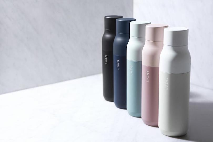 series of five colored reusable water bottles