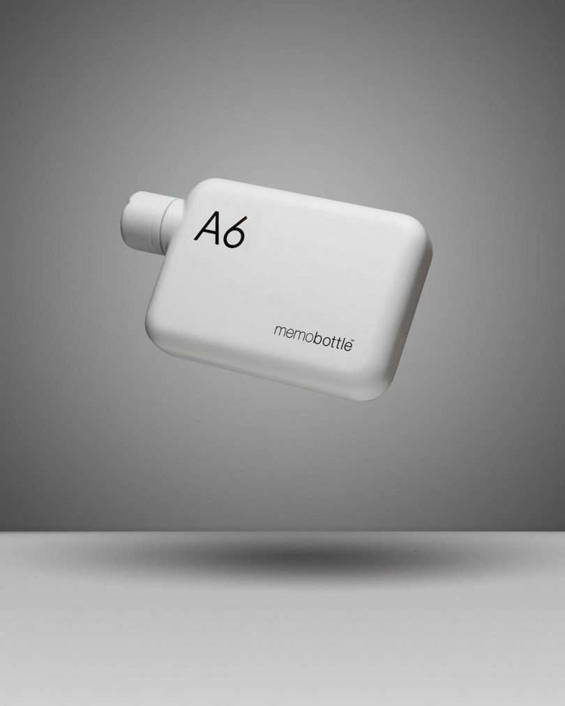 white A6 flat water bottle floating