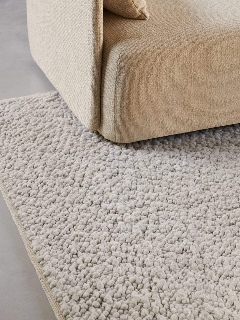 tan textured rug corner