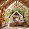 open roof cabin in woods with bed