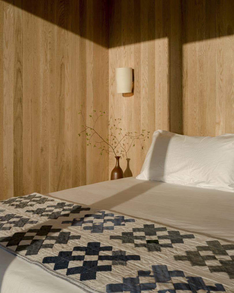 Interior of Piaule Cabin featuring Piaule bedframe