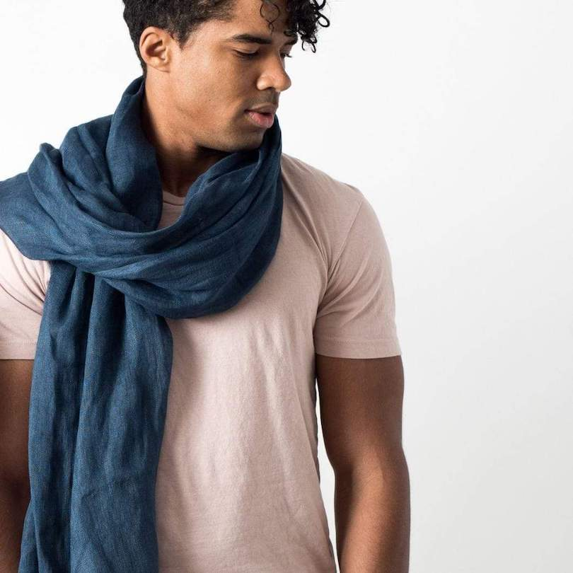 man in pink shirt with blue scarf wrapped around neck