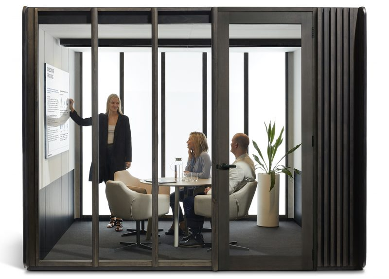 large modular work space with three people inside