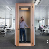 small modular work unit with man standing inside