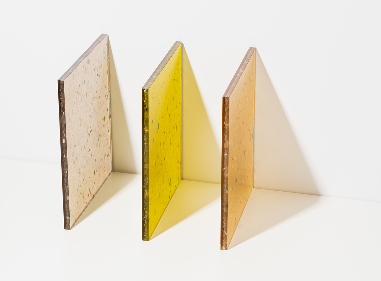 three squares of neutral tones leaning against white wall