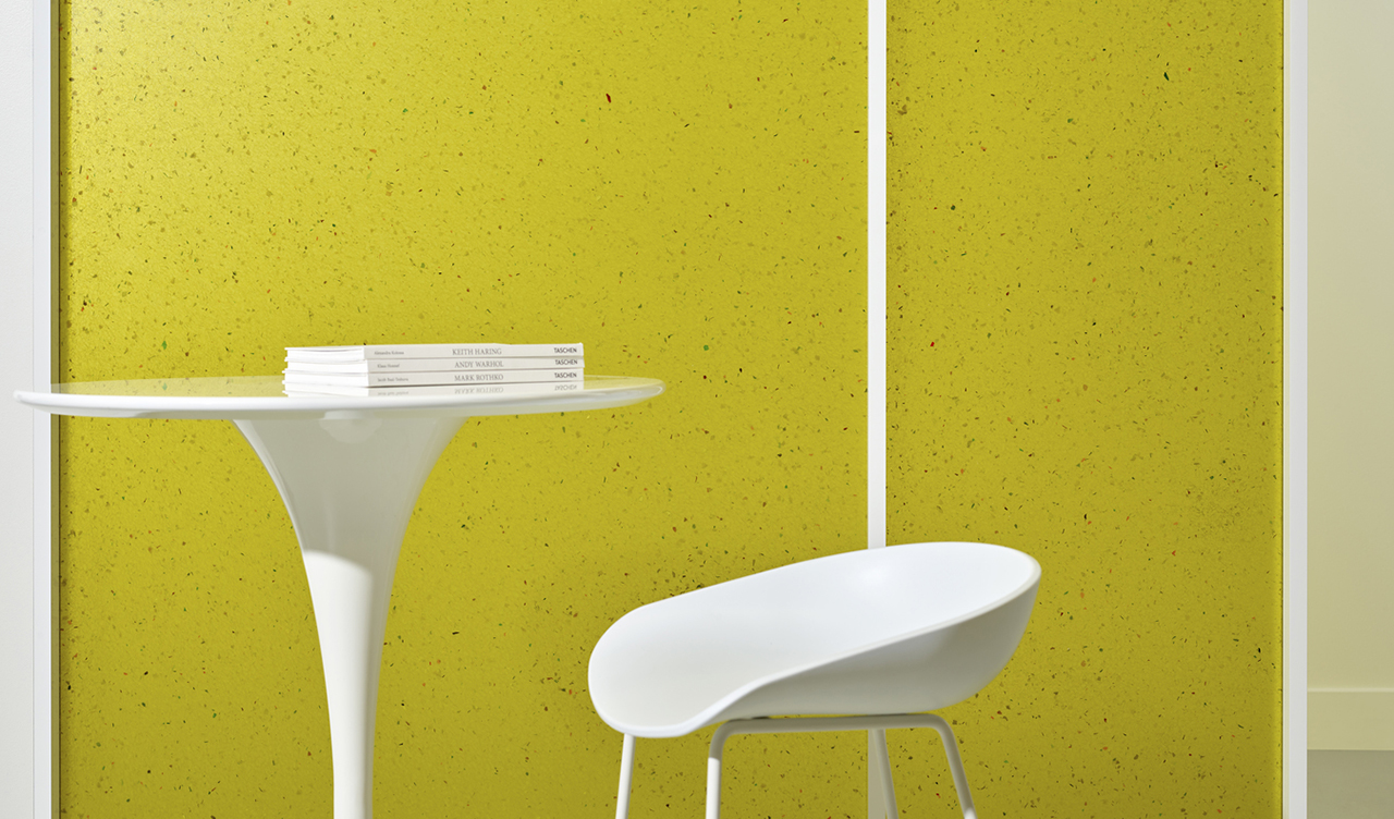 white table and white stool in front of yellow-green partition