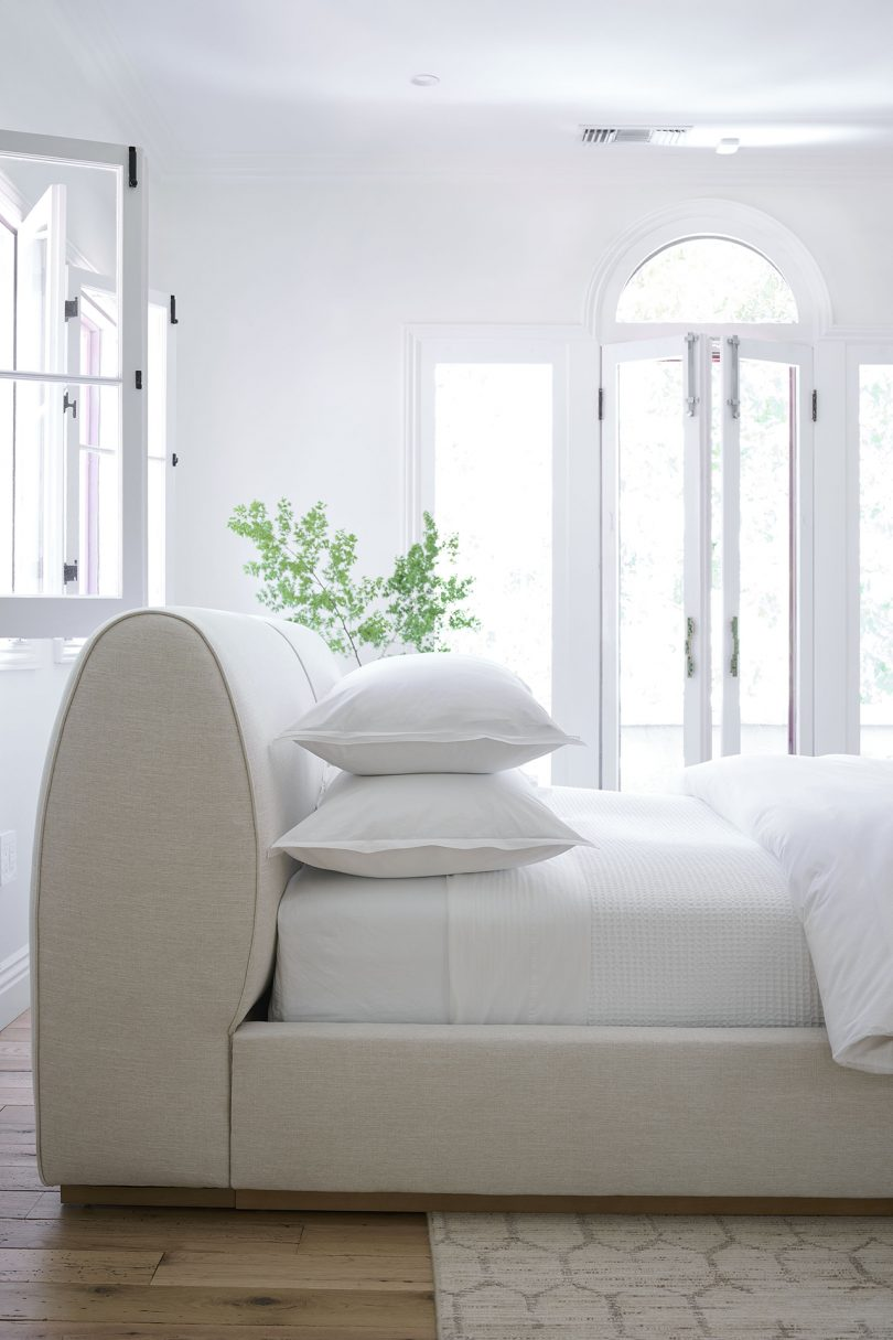 bright white bedroom with bed