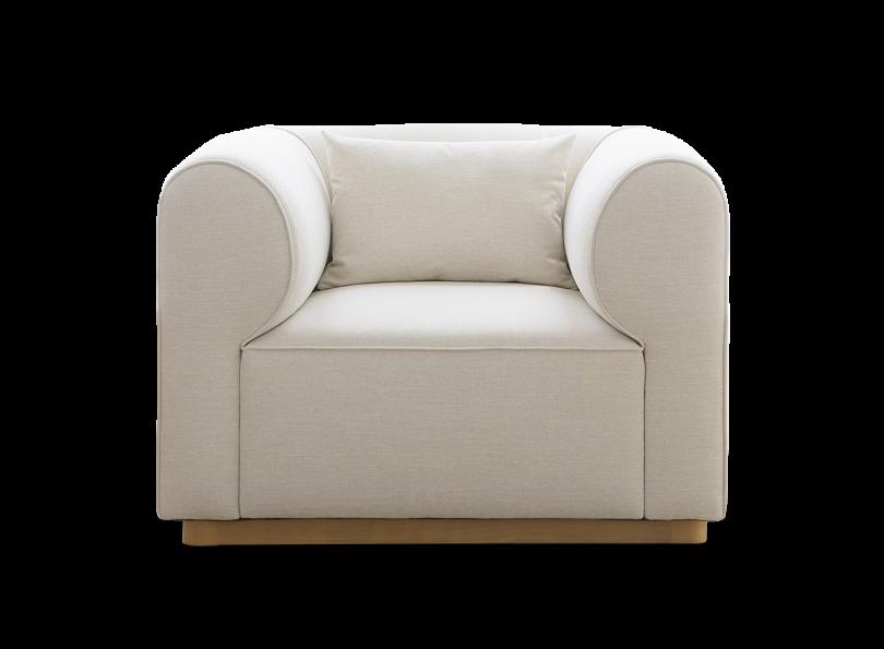 bulky white armchair on white background